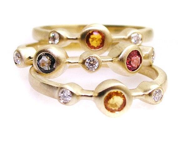 Multi color sapphire ring .