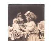 Antique French Postcard. Girl Playing with Dolls. French Antique. Toys. Sepia Photography. Studio Photo. 1900s Paper Ephemera.