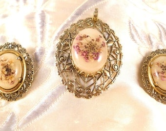 A  Dried Flowers Resin Dome cameo pendant and earrings