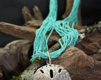 Long Turquoise Necklace with Seed Beads with a Large Sand Dollar Pendant