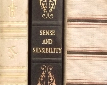 Sense and Sensibility by Jane Austen book bound in faux leather, dark blue