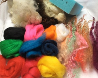 Needlefelt kit. Includes washed British fleece, 10 shades of Merino tops,sponge,wool curls, 2 needles and instructions. 'Circus time'