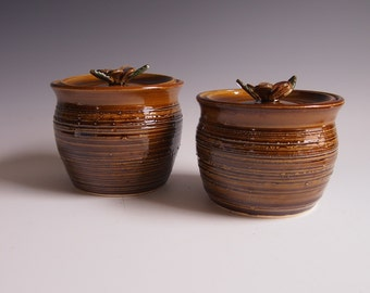 Wheel thrown brown, textured lidded ceramic jars- plumeria handles