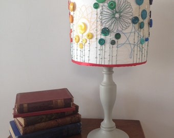 Rainbow drum lampshade, stitched with spirograph and button detail
