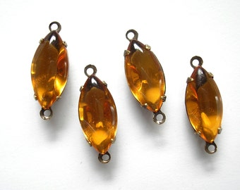 Four Piece Set of Topaz Glass Navettes in Brass Connector Settings