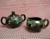 Brown drip glaze cream and sugar in unique design vintage pottery