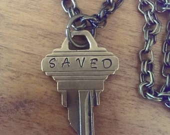 Hand stamped SAVED vintage key necklace