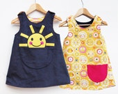 Girls sunshine printed reversible dress