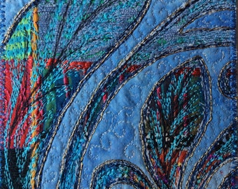 Textile art: blue leaf machine embroidery