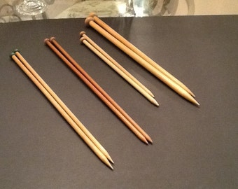 Four sets of vintage knitting needles.