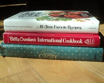 3 Vintage Cook Books, Hard Cover Editions of Betty Crocker's International Cookbook, Better Homes and Gardens and Land O Lakes, Well Used