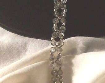 Bracelet/woven smoke colored 4mm round Swarovski crystal/crystal heart toggle clasp/7 1/2 inch/Free USA shipping only