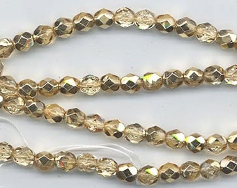 One 16-inch strand 6 mm crystal/metallic gold glass firepolished beads 499