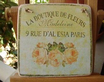 La boutique de fleurs, vintage French style, faded shabby roses, advertising mage on wooden tag