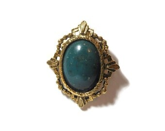 Green stone pendant brooch, probably jasper, genuine stone cabochon with a gold plated frame, interchangeable