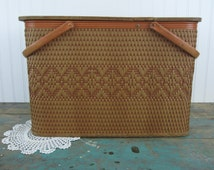 Vintage Redmon Picnic Basket with Pie Shelf and Partial Dish Set with hinged lid and swing away handles