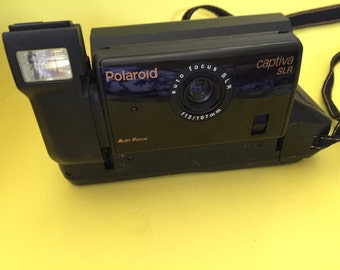 Very Retro Polaroid Captiva SLR Instant Film Camera - Comes with a non-working film package