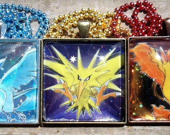 Of Fire, Ice, and Lightning: Articuno, Zapdos, Moltres - Legendary HOLO Japanese Glass Pendant Charm