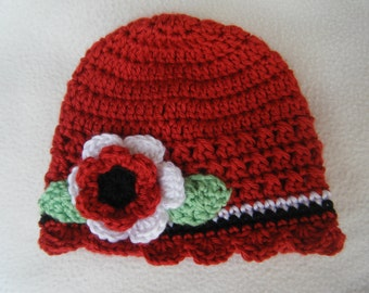 Crocheted Red Baby Hat with Red, Black and White Flower