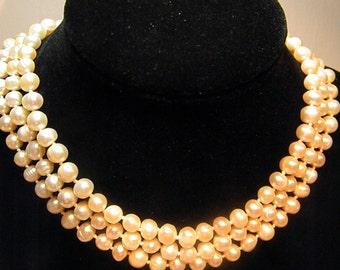 Three strand natural cultured freshwater peach pearl choker