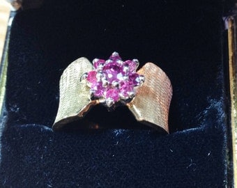 Natural Ruby ring set in thick 14K gold band.
