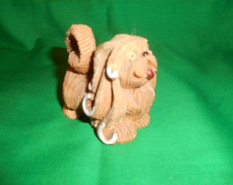 One (1), DeRosa Rinconada, Retired #101 Pekingese Dog Figurine, Circa 1978.