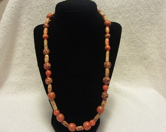 Beaded Necklace With Orange Beads And Brown Wooden Beads