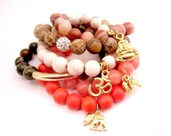 Stackable Beaded Bracelets. Buddha Charm. Om Charm. Elephant Charm. Key Charm. Jade Beads. Jasper Beads. Malachite Beads.