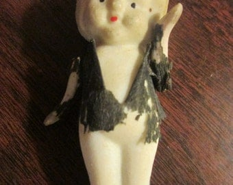 Little Bisque Doll with Movable Arms and Tattered Clothing