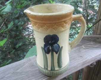 antique stoneware pitcher leaves and iris
