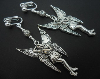 A pair of tibetan silver large fairy angel clip on earrings.