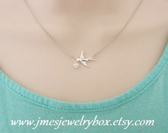 Silver flying sparrow necklace with freshwater pearl