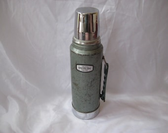 Large green stanley thermos with carrying handle, green metal thermos, one quart