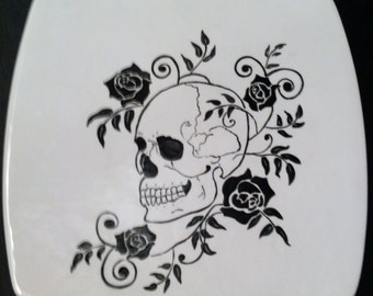 hand painted skull with delicate roses
