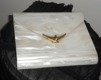 white lucite  pearlized  marbilized clutch purse  could work as shoulder but you need to add a strap  plastic lucite