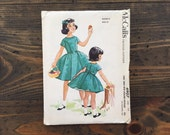 1950's McCall's pattern 4907 • girl's dress with attached petticoat • size 12 • uncut pattern