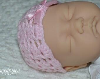 Newborn lace crochet hat in pink.