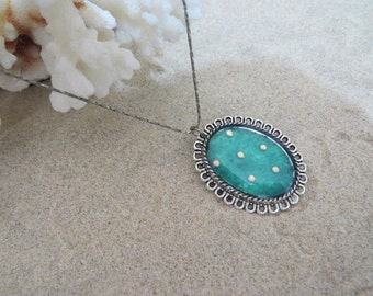 Golden dots on turquoise backgrond pendant...