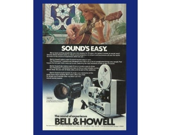 Bell & Howell Filmosonic Super 8 Camera and Sound Projector Original 1977 Vintage Color Print Ad - Beautiful Woman Playing Guitar