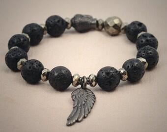 Tribal stretch bracelet, lava stone, pyrite, black buddha head and angel wing