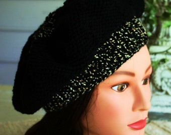 Get two for One with this hand knitted Tam that's reversible.  The body of the hat is black then adorned with black and gold fleck trim
