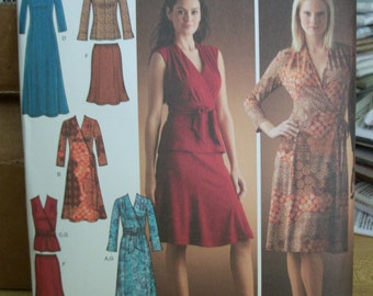 Simplicity 4074  Misses/Miss Petite  (Size H5 6 to 14) & (R5 14 to 22) knit dress or top with front variations, pullon skirt and sash UNCUT