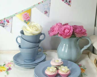 Woods ware utility teacups and saucers and cake plate. Teacup trio in woods ware iris pattern.