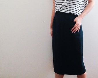 Dark green wool skirt with pockets