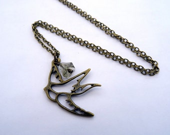 Bird necklace - flower bead - antique bronze charm vintage inspired swallow