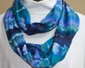 61 inch infinity loop scarf.  Silky tropical print features blues and purples in a floral print.