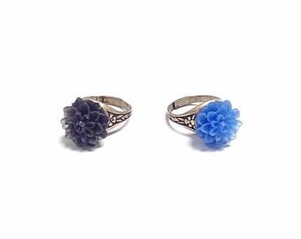 Blue flower ring, black flower ring