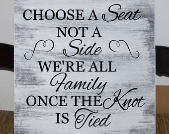 Choose a seat not a side, we're all family once the knot is tied wood wedding sign 12x12
