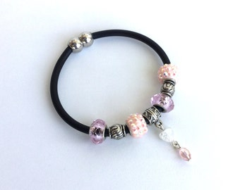 Pink European bead rubber cord bracelet with crystal charm