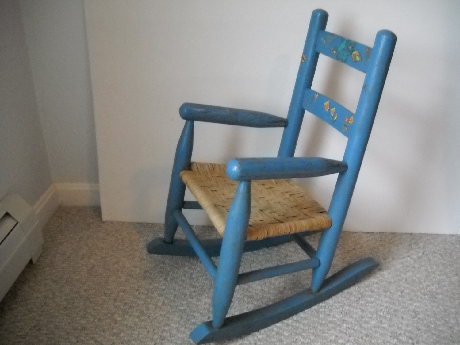 Childs Wooden Rocking Chair painted blue with decor.